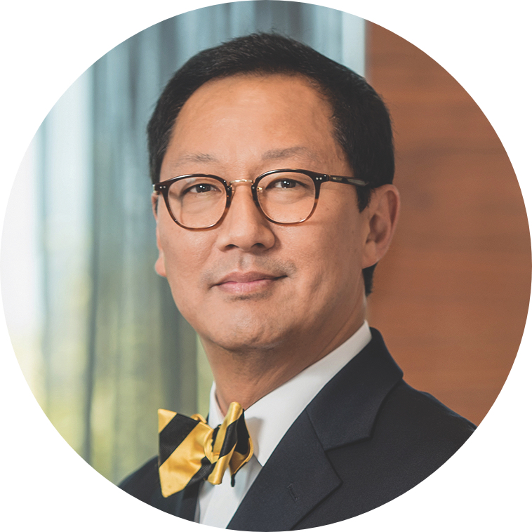 A portrait photograph of Santa Ono, president of UBC wearing a yellow and black bowtie.